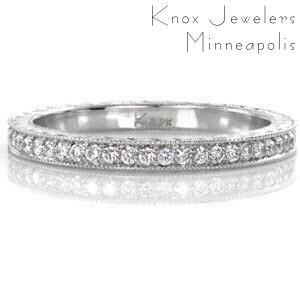 This classic eternity band features elegant details flowing around the entire ring for a seamless finish . The top of the band is bead set with micro pavé diamonds that sparkle vibrantly. The two sides are hand engraved with a half-wheat pattern that captures light in the bright cuts for added dimension.