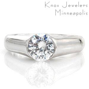 Luna is a high-polished contemporary design featuring a 1.0 carat diamond. The smooth finish of the band heightens the brilliance of the center stone. Raised shoulders extend in a cathedral to the top of the diamond. The open half-bezel displays the lovely silhouette of the round diamond for a picturesque view.