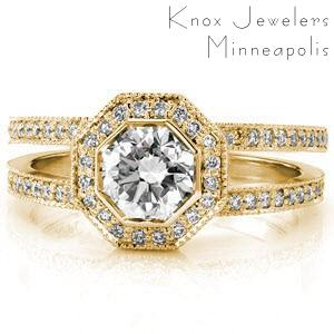 Custom split shank engagement ring with micro pave diamond bands with a round center diamond held in a bezel and surrounded by an octagon shaped diamond halo.in Akron.
