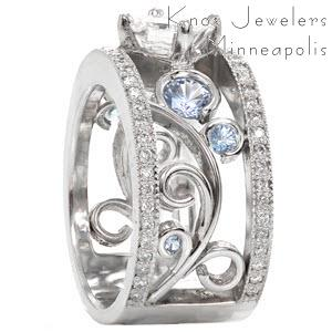 Nic and Alex filigree engagement ring with light blue sapphires