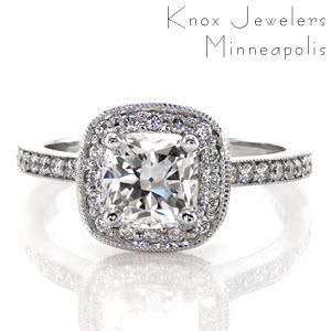 This ring style is a fashion-forward design with its cushion halo and center stone. micro pavé diamonds accentuate the 1.0 carat cushion cut diamond in the halo and along the band. The raised shoulders showcase the halo as well as allowing a great fit for a diamond wedding band.