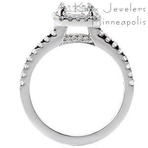 Thin diamond pave band with diamond halo surrounding a rectangular cushion cut diamond