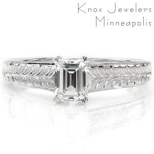 The hand engraved wheat pattern along the top of the band draws the eye to the linear lines of the step-cut center stone. A double prong around each clipped corner of the 0.65 carat emerald cut securely fashions the diamond. The polished sides adds a sleek appeal to this vintage inspired design.