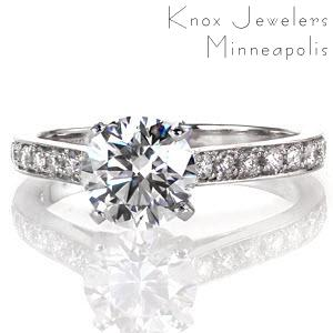 Mariposa is a magnificent design featuring a 1.25 carat round brilliant cut center diamond in a cathedral setting. The band is elegantly appointed with large micro pavé diamonds and it gracefully curves up to meet the raised center stone; the way light dances off of the diamonds is simply divine.