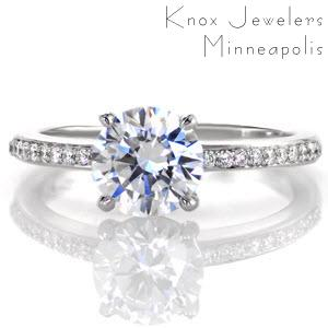 Micro pave engagement ring in Houston with round brilliant center stone and white gold setting.