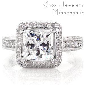 A 2.00 carat princess cut diamond is the center of attention in this vintage ring. With a double row of diamonds within the square halo, this design radiates. Multiple rows of micro pavé diamonds adorn every side of the ring. Two peek-a-boo diamonds add the finishing touch to this gorgeous ring.