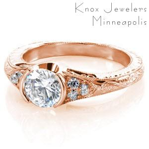Antique engagement ring in Edmonton with filigree, milgrain and half bezel center stone.