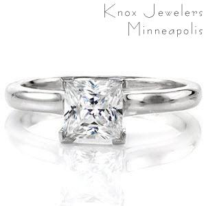 Sedona Solitaire is a modern engagement ring with the contemporary 1.00 carat princess cut center stone. The smooth polished cathedral contours up towards the diamond, giving the band dimension and style. The V-shaped chevron prongs protect the edges of this square diamond and adds an element of design.