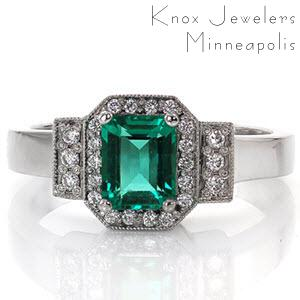 The vivid green emerald is surrounded in a halo of diamonds that mimics the shape of the emerald cut center. The halo and parallel rows of three diamonds are outlined in milgrain detail to contrast the smooth lines of the polished band. The 14k white gold finish compliments the bold color of the gemstone.