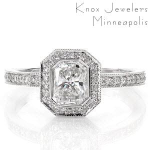 The modern lines of the full bezel envelop the 0.75 carat radiant diamond in streamlined sophistication. The octagonal shaped halo and band radiates with micro pavé accents and milgrain edging. The design proudly displays the center stone culet and smartly allows space for a band to sit flush.