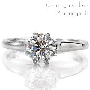 The Vitoria is an elegant solitaire design. The eight prong setting is a decorative element chosen to provide an antique flare to the ring. The band flares out as it reaches the center stone setting and is finished with a high polish. The center stone can be customized in shape, size, and stone type.