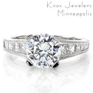 Custom engagement ring in Oakland with round brilliant center stone and channel set princess cut side stones.