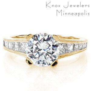 Engagement ring in St. Cloud with round brilliant center stone and channel set princess cut diamonds.