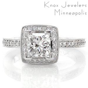 Maui is a unique halo design featured with a 0.80 carat princess cut. The V-tip prongs safely secure the square edges of the center stone while adding a pleasing design element. micro pavé diamonds line each side of the band and frame a square halo around the princess cut for a mesmerizing sight.