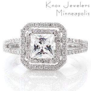 Cassandra is a diamond lover's dream. A double halo of micro pavé diamonds frames the 1.0 carat princess cut, adding beautiful radiance and incredible width. The micro pavé diamonds continue along the delicate split-shank band. Milgrain chevron detail adds intrigue and uniqueness under the halo.