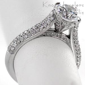 Charlotte micro pave engagement ring with rows of diamonds and round brilliant center stone.