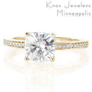 Memphis cushion cut engagement ring with diamond band in yellow gold.