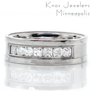The Denali design is a sophisticated wedding band featuring seven small asscher cut diamonds in a channel setting. The middle of the band has a sandblasted finish and the wide rails are given a high polish. This contrast helps to highlight the 0.68 total carats of diamonds.