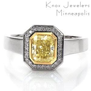 The classic Art Deco era is the inspiration behind the Heidi design. The 1.00 carat fancy yellow radiant cut center diamond is accented by a 14k yellow gold bezel and then wrapped in a 14k white gold halo of hand set micro pavé diamonds and a wide high polish band designed for comfort.