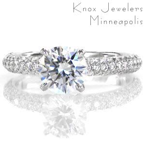 Sonata is a classic and sophisticated ring. A delicate four prong crown holds a 1.0 carat round brilliant diamond. The three rows of micro pavé diamonds along the band add tremendous radiance when the light reflects along the stones. The band has a round comfort fit profile for additional softness.