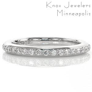 This classic wedding band is designed to match the Round Halo Engagement Ring but can be paired with a variety of other ring styles. Brilliantly cut stones are bead-set in a single row across the top of the band. Stones go halfway around the band leaving smooth, high polished sides along the remainder of the design.
