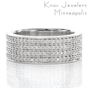 This magnificent wide band is lavished in 4 rows of micro pavé. Each round brilliant cut diamond is prong set by hand, and each row of stones is separated by a line of milgrain texture. This beaded pattern adds a refined finish that blends the stones together to create a gorgeous ring that dances in the light.