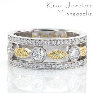 Unique custom wide band ring in Henderson with bead set diamond rails bordering a two tone design.