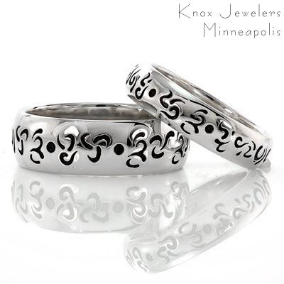 This matched set of wedding bands were custom created in 14k white gold. The inset pattern on the bands was blackened using an antiquing process. The contrast between the rich darkness of the pattern and the luster of the high polished gold adds dimensions to these unique rings.