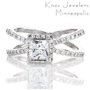 Galaxy is a unique design inspired by the night sky. The criss-crossing bands and raised halo are all adorned with micro pavé that will twinkle like the stars. The 0.75 carat princess cut diamond is the center of attention with chevron prongs holding the corners securely in place.