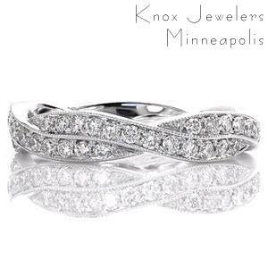 Fargo diamond band with a woven pattern and bead set diamonds.