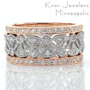 This enchanting right hand ring is a two-tone piece using 14k white and rose gold. The pattern consists of fan shaped cut-outs accented with diamonds and bordered by two bands of micro pavé. The rose gold side bands add subtle color for a beautiful contrast from the white of the diamonds.