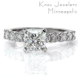 Kelsey Marie is a classic beauty with round brilliant cut diamonds in prong settings adorning the band. The center stone is a 1.50 carat radiant cut in an elevated setting. Vibrant stones dazzle with a prism of colors in any light. The 14k white gold metal reflects the same brightness as each of the diamonds.