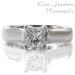 Mastering a modern sophisticated style, the Newell design engagement ring features a 1.00 carat princess cut center diamond. A 14k white gold high polished cathedral setting contours upwards towards the center stone. Stately V-shaped prongs protect the stones corners and contribute to its contemporary appeal.