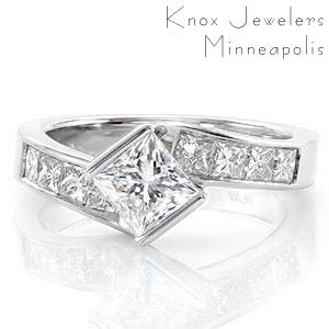 Design 2088 boldly displays the crisp lines of a formal 1.00 carat princess cut diamond. The half bezel setting twists to secure the top of the center stone in a kite-set position. Square princess cut side stones are channel set into the handcrafted 14k white gold band.