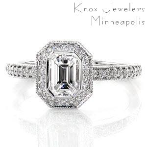 The bright-cut bead-set diamond halo captivates a stunning 0.75 carat emerald cut center diamond in the Emerald Bezel Elegante. Divine lines with milgrain edges join the comfortable Euro shank fit and pedestal halo providing this ring with a stunning profile.