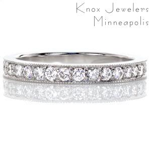 Pave incorporates the classic round brilliant shape along the length of the band for a timeless statement. The white gold metal enhances the sparkle of the round diamonds for a radiant sight. Bright cuts are made along the edge of the band then textured with milgrain for added brilliance.