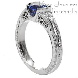 Seville Engagement Ring with a deep blue diamond cut sapphire.  Hand engraved with hand done filigree on this Unique Engagement Ring.