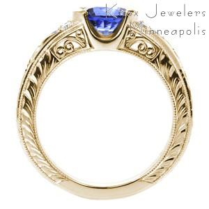 Filigree engagement ring in Kansas City with blue sapphire center stone, hand engraving and filigree.
