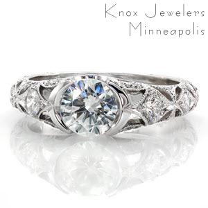 Washington D.C. engagement ring with half bezel round center stone and intricate patterns along the band.