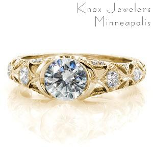 Antique engagement ring in Indianapolis with half bezel center stone and intricate diamond band. This beautiful yellow gold engagement ring features a star burst pattern on the band set with diamonds.