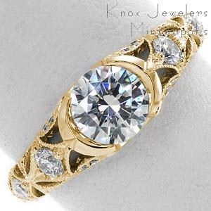 Madison wedding ring with ornate patter, half bezel center stone and milgrain detail.