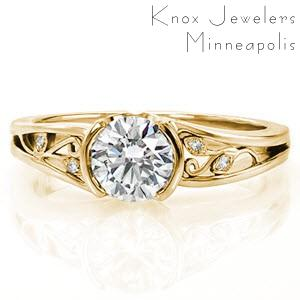 Filigree engagement ring in Allentown with half bezel center stone and yellow gold setting.