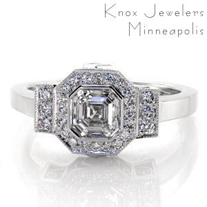 Art Deco inspiration is reflected in Design 2163. The center displays a full bezel set, .90 carat, asscher center with a octagonal micro pavé diamond halo. The design merges into a rectangular row of bead set diamonds and polished band. Two carré cut diamonds and filigree curls decorate the sides.