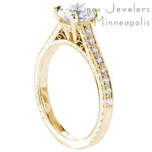 Antique engagement ring in Oakland featuring a yellow gold setting with scroll filigree, hand engraving and micro pave diamonds.