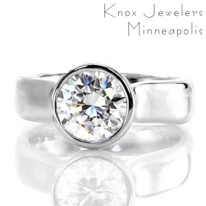 Twilight is a sophisticated engagement ring. The thick contemporary bezel contours the round outline of the 2.0 carat center stone. Set far above the mounting, the heightened cathedral displays the acclaimed profile of a round brilliant. The polished 14k white gold glistens from every angle.
