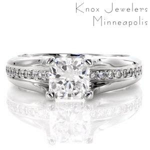 Our Radiant River is an intriguing design where micro pavé diamonds seamlessly flow beneath the center .80 carat radiant cut diamond. The four prongs of the center diamond stretch upward from the band, proudly displaying the perfectly set center stone.