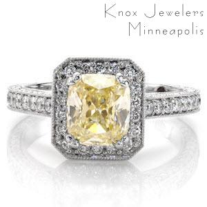A stunning 1.0 carat cushion cut fancy yellow diamond takes center stage in this vintage inspired ring. micro pavé diamonds adorn the clipped corner halo. Decorative diamond and crescent shapes enhance the under bezel. Filigree, milgrain and micro pavé diamonds accentuate the band design.