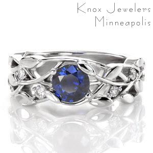 This sapphire engagement ring is a beautiful low-profile setting that rests closely to the finger. The nature-inspired design resembles a delightful leaf and vine pattern for an organic feel. A vivid 0.70 carat blue sapphire is intertwined and securely fashioned between petal-shaped prongs.
