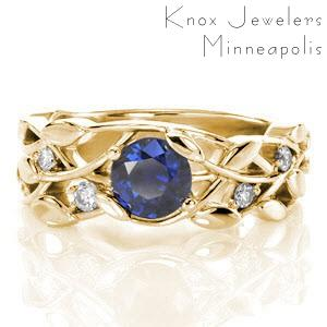 Sapphire engagement ring in Buffalo set within a nature inspired pattern.
