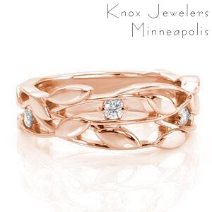 Wide band wedding ring in Sarasota with nature inspired patterns and diamonds.